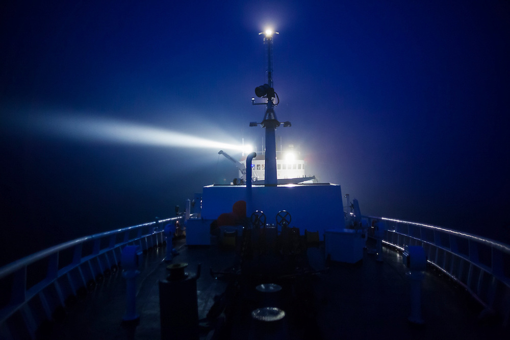 The MS Stalbas shines a search light into thick fog off the coast of Spitsbergen, Svalbard, looking for the small Polish sailing yacht Eltanin charged with ferrying some of the crew back to Longyearbyen.