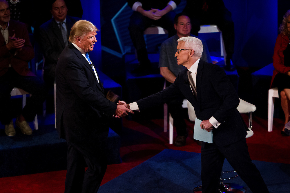 Republican U.S. Presidential candidate Donald Trump shakes hands with CNN anchor Anderson Cooper at the CNN Town Hall at Riverside Theater in Milwaukee, Wisconsin March 29, 2016. REUTERS/Ben Brewer