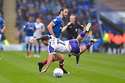Portsmouth Defender, Christian Burgess (6) fouls Rotherham United Midfielder, Jon Taylor (11) during the EFL Sky Bet League 1 match between Portsmouth and Rotherham United at Fratton Park, Portsmouth, England on 3 September 2017. Photo by Adam Rivers.