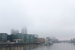 © Licensed to London News Pictures. 17/12/2017. London, UK. The shard is shrouded in freezing fog, seen across the River Thames this morning. The capital experienced another very cold night with freezing weather. Photo credit: Vickie Flores/LNP
