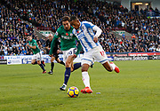 Huddersfield Town's Rajiv van La Parra goes past West Bromwich Albion's Grzegorz Krychowiak  during the Premier League match between Huddersfield Town and West Bromwich Albion at the John Smiths Stadium, Huddersfield, England on 4 November 2017. Photo by Paul Thompson.