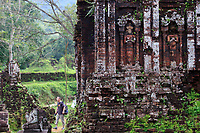 A tourist wanders through the My Son Sanctuary Hindu temple complex in central Vietnam