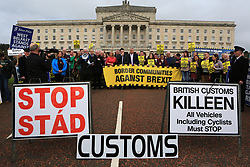 © London News Pictures. 29/03/2017. Campaign group Border Communities Against Brexit arrive with concern politicans to hold a protest at Stormont, Belfast, Northern Ireland, Wednesday 29th, March, 2017. Britian's Prime Minister Theresa May triggered Article 50 of the Lisbon Treaty starting a two year countdown to the UK's exit. Photo credit: Paul McErlane/LNP