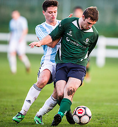 Gala Fairydean Rovers David Bonnar and Edinburgh University&rsquo;s Ross Patterson. <br /> Edinburgh University 2 v 3 Gala Fairydean Rovers, Scottish Sun Lowland League game played 15/11/2014 at Peffermill Playing Fields.