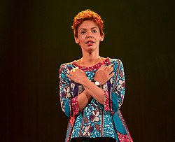 Edinburgh, Scotland, UK. 14 August 2019. Preview performance of the play Red Dust Road by the National Theatre of Scotland at the Lyceum Theatre during the Edinburgh International Festival 2019. <br /> Chronicling Jackie Kay's 20-year search for her biological mother and father and her quest for them to recognise her own existence. <br /> <br /> Red Dust Road is adapted from the memoir by Jackie Kay, poet, playwright, novelist and Scottish Makar. It's a journey full of heart, humour and profound emotion, exploring race, identity and family secrets, with a deeply human curiosity and compassion.<br /> Red Dust Road is adapted for the stage by Tanika Gupta, winner of last year's James Tait Black Prize for her drama Lions and Tigers. Pictured Sasha Frost ( Jackie). Iain Masterton/Alamy Live News ++ Editorial Use Only ++