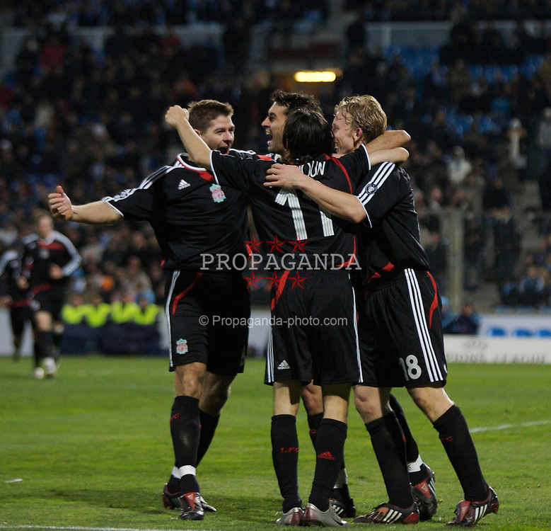 MARSEILLE, FRANCE - Tuesday, December 11, 2007: Liverpool's Dirk Kuyt (R) celebrates scoring the third goal against Olympique de Marseille with team-mates L-R captain Steven Gerrard MBE, Alvaro Arbeloa and Yossi Benayoun during the final UEFA Champions League Group A match at the Stade Velodrome. (Photo by David Rawcliffe/Propaganda)
