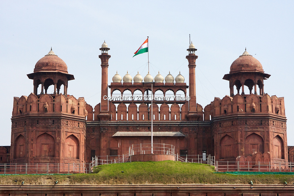 The Indian Flag flies proudly above the Lahori Gate, the main entrance to the Red Fort in Old Delhi, India. The gate received its name because it is oriented towards the city of Lahore, in Punjab, Pakistan