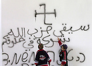 "Children of Jewish settlers point out spray painted swastikas and slogans in Arabic reading ""Hezbollah will stick in your throat like a bone""and in Hebrew reading ""Hitler destroys the germs"", written by suspected Palestinian intruders that vandalized the main synagogue of the West Bank Jewish settlement of Erfrat Friday Oct. 27, 2000."