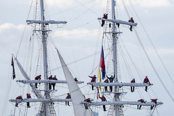 © Licensed to London News Pictures. 16/04/2017. London, UK. Crew stand in the rigging of TS Royalist. More than 30 ships from around the world take part in the Parade of Sail, the culmination of the Royal Greenwich Tall Ships Festival 2017.  Greenwich also marks the start of the Rendez-Vous 2017 Tall Ships Regatta, where these ships will journey to Quebec to mark the 150th anniversary of the Canadian Confederation. Photo credit : Stephen Chung/LNP