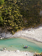 A group of people rafts down the Shotover River in Skipper's Canyon, near Queenstown, Otago, New Zealand.