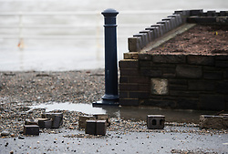 © Licensed to London News Pictures. 27/01/2016. Aberystwyth, UK.  Damage caused to a wall by waves at Aberystwyth in wales at high tide. The tail end of storm Jonas continues to hit the UK, bringing torrential rain and galesPhoto credit: Keith Morris/LNP