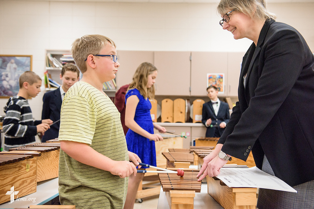 Teacher Kaethe Grabenhofer works with a student during music class on Friday, Oct. 28, 2016, at First Immanuel Lutheran School in Cedarburg, Wis. LCMS Communications/Erik M. Lunsford