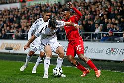 Daniel Sturridge of Liverpool is challenged by Jordi Amat of Swansea City - Photo mandatory by-line: Rogan Thomson/JMP - 07966 386802 - 16/03/2015 - SPORT - FOOTBALL - Swansea, Wales — Liberty Stadium - Swansea City v Liverpool - Barclays Premier League.