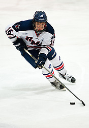 March 12 2016: Robert Morris Colonials forward Greg Gibson (16) skates with the puck during the third period in game two of the Atlantic Hockey quarterfinals series between the Bentley Falcons and the Robert Morris Colonials at the 84 Lumber Arena in Neville Island, Pennsylvania (Photo by Justin Berl)