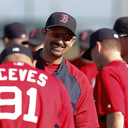 February 19, 2011; Fort Myers, FL, USA; Boston Red Sox first baseman Adrian Gonzalez talks with relief pitcher Alfredo Aceves (91) during spring training at the Player Development Complex.  Mandatory Credit: Derick E. Hingle