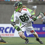Matt Gibson #66 of the New York Lizards controls the ball during the game at Harvard Stadium on July 19, 2014 in Boston, Massachusetts. (Photo by Elan Kawesch)