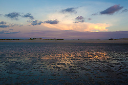 On a spring tide, vast tracts of beach are exposed, making for beautiful sunsets in the reflected water.