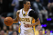 March 14, 2012; Indianapolis, IN, USA; Indiana Pacers shooting guard George Hill (3) brings the ball up court against the Philadelphia 76ers at Bankers Life Fieldhouse. Indiana defeated Philadelphia 111-94. Mandatory credit: Michael Hickey-US PRESSWIRE