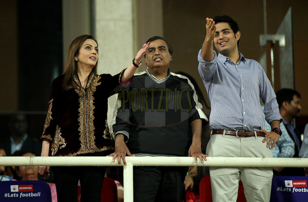 Nita Ambani, Founding Chairperson of the Hero Indian Super League, Mukesh Ambani and Akash Ambani during the final of the Hero Indian Super League between Kerala Blasters FC and Atletico de Kolkata held at the D.Y. Patil Stadium, Navi Mumbai, India on the 2oth December 2014.<br /> <br /> Photo by:  Sandeep Shetty / ISL/ SPORTZPICS