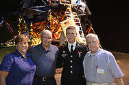 L-R, CAROL BARTLETT, former NASA Apollo astronaut FRED HAISE, SEAN BARTLETT of East Stroudsbury, PA, wearing U.S. Army Reserves uniform, and CHARLIE KEENAN, 85, of Centerport, are at a Summer of '69 Celebration Event held at the Long Island Cradle of Aviation Museum, on the 45th Anniversary of NASA Apollo 11 LEM, lunar module, landing on the moon July 20, 1969. Keenan, who is Sean's grandfather and Carol's father, is a Grumman retiree who was a LEM electrical power subsystem engineer, went with his family to the Graumman former employees reunion.