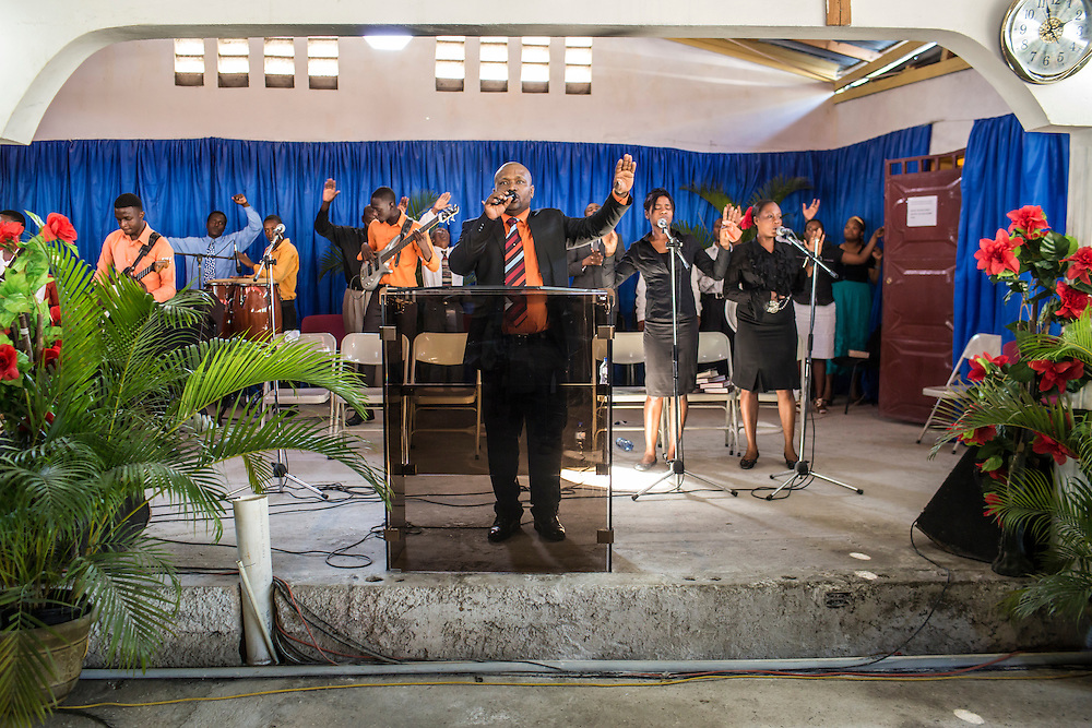 Televangelist Marcorel Zidor preaches at L'Eglise Evangelique Piscine de Bethesda in its temporary home on Saturday, December 20, 2014 in Port-au-Prince, Haiti. Pastor Zidor attracts a large audience with his emotional services and miracle medical cures of dubious theraputic value.