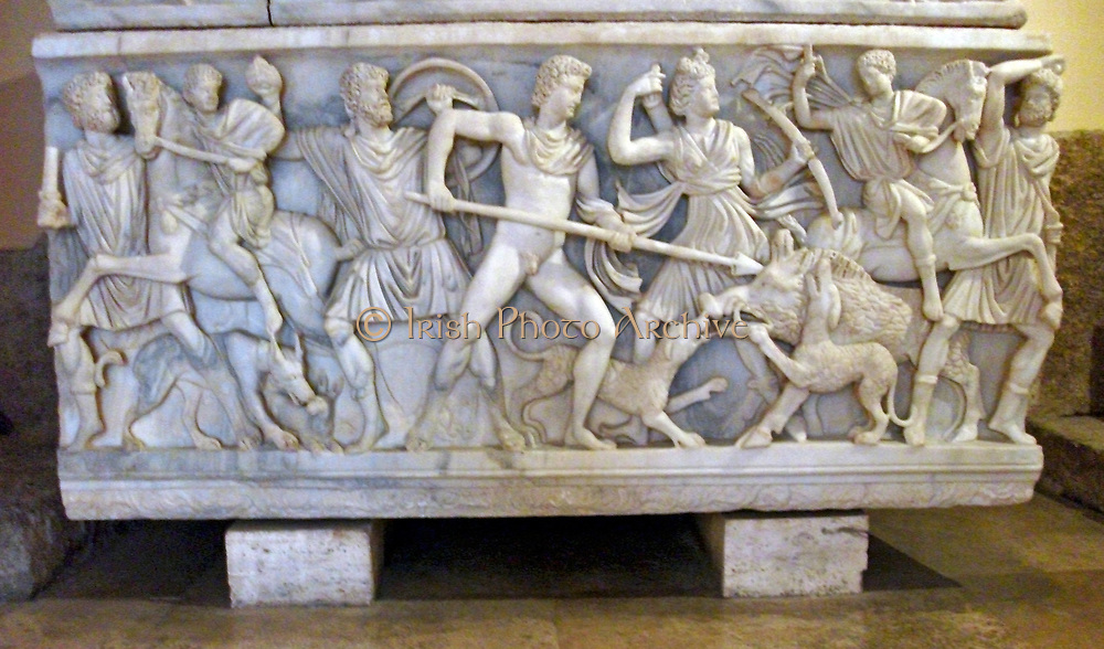Roman sarcophagus featuring scenes of the Calydonian Boar Hunt. Made from Proconnesian marble. The lid features an unfinished reclining couple. At the Capitoline museum. Circa 1st-3rd century AD.