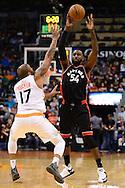 Dec 29, 2016; Phoenix, AZ, USA;  Toronto Raptors forward Patrick Patterson (54) makes a pass over Phoenix Suns forward P.J. Tucker (17) in the first half of the NBA game at Talking Stick Resort Arena. Mandatory Credit: Jennifer Stewart-USA TODAY Sports