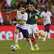 Rafa, (left), Portugal, is challenged by Héctor Herrera , Mexico, during the Portugal V Mexico International Friendly match in preparation for the 2014 FIFA World Cup in Brazil. Gillette Stadium, Boston (Foxborough), Massachusetts, USA. 6th June 2014. Photo Tim Clayton