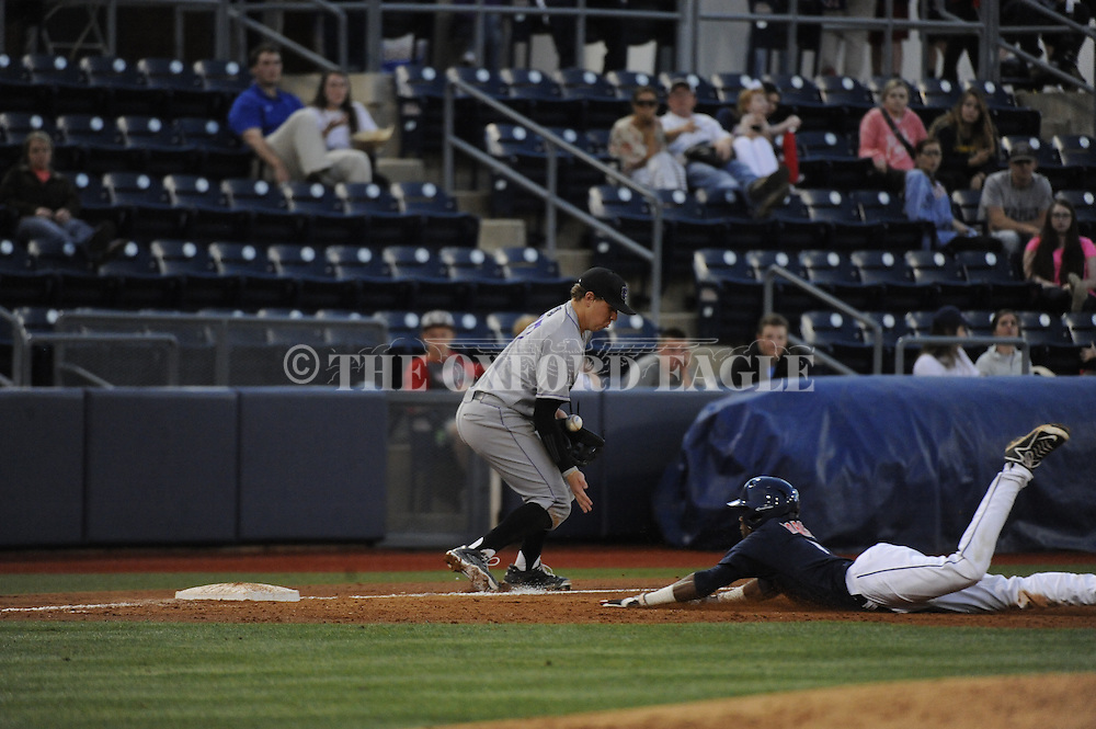 Ole Miss' Errol Robinson (6) slides into third as Central Arkansas' Hayden Steele (37) in college baseball action on Tuesday, April 21, 2015.