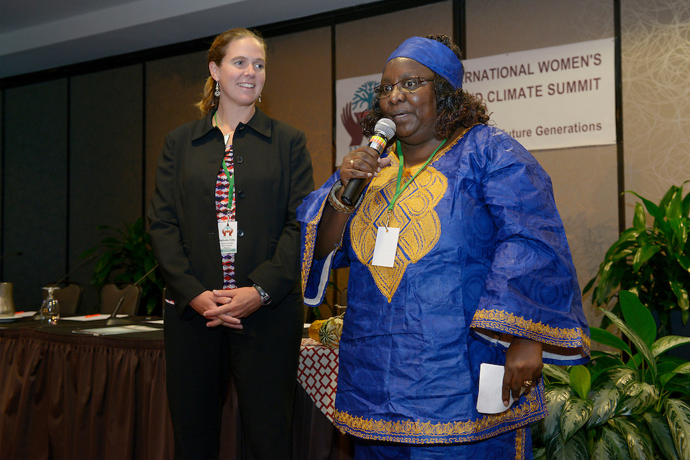 Delegates Nathalie Eddy (USA), left, and Lucy Mulenkei (Massai/Kenya) welcome the participants for the second day of the International Women's Earth and Climate Summit Saturday September 21, 2013 in Suffren NY.Leaders from 35+ countries gathered for the drafting of a Women's Climate Action Agenda in Suffern, New York September 20-23rd, 2013 as part of the International Women's Earth and Climate Summit.  For a full list of Summit delegates and an agenda visit www.iweci.org. Photo by Lori Waselchuk/Magazines OUT