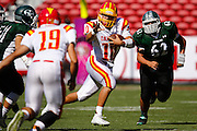 Oakdale quarterback Adam Olsen (10) carries the ball against Manteca during Friday Night Lights at Levi's Stadium in Santa Clara, California, on October 11, 2014. Oakdale beat Manteca 42-21. (Stan Olszewski/ Special to The Record)