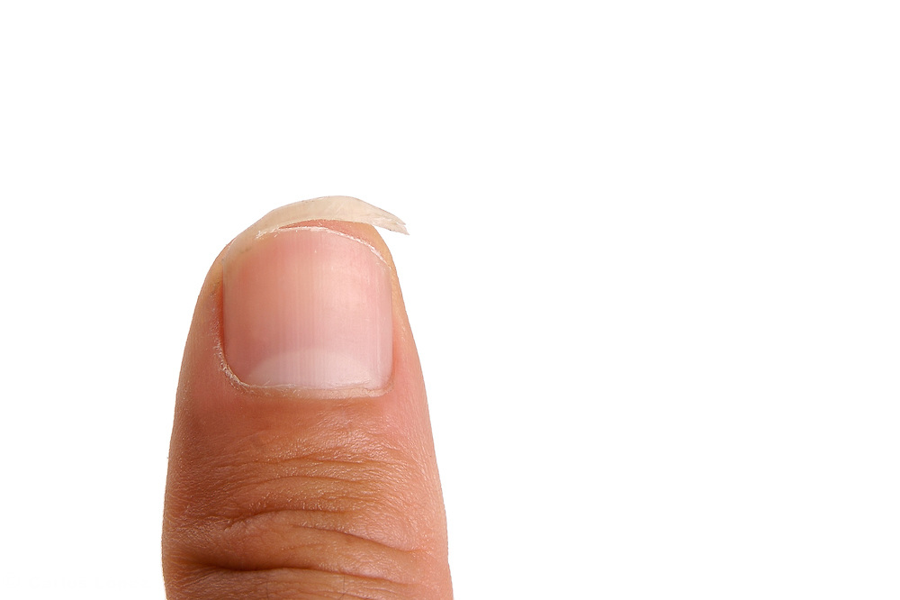 A finger with a nail in progress of being cut.