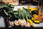 Fresh vegetables prepared by Sayo Ukita. Green pepper, string beans, yellow squash, and daikon radish. Kodaira City, Japan. Material World Project. The Ukita family lives in a 1421 square foot wooden frame house in a suburb northwest of Tokyo called Kodaira City.