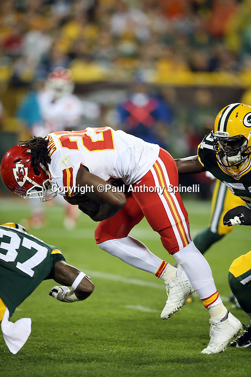 Kansas City Chiefs running back Jamaal Charles (25) breaks a tackle attempt by Green Bay Packers inside linebacker Nate Palmer (51) and Green Bay Packers cornerback Sam Shields (37) as Charles runs the ball on a 9 yard run for a second quarter touchdown that cuts the Green Bay Packers lead to 17-7 during the 2015 NFL week 3 regular season football game against the Green Bay Packers on Monday, Sept. 28, 2015 in Green Bay, Wis. The Packers won the game 38-28. (©Paul Anthony Spinelli)