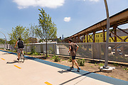 Runners at Milwaukee Avenue along the 606 elevated bike trail, green space and park built on the old Bloomingdale Line in the Wicker Park neighborhood in Chicago, Illinois, USA