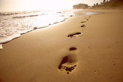 Dominican Republic, 2003 - Sunrise and footprints on the pristine beach near Cabarette.
