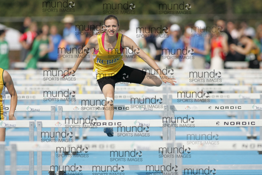 Olivia Cook competing in the midget girls 80m hurdles qualifying round at the 2007 OFSAA track and field championships held in Ottawa.