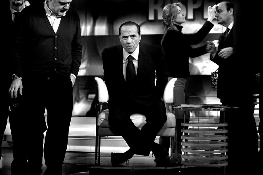 "Italian Prime Minister Silvio Berlusconi adjustes his microphone before taking part at the  in a politic talk show at the italian ""RAI"" broadcast studios .The italian politics leader made his first TV appereance after 8 months, to draw a balance of his five years government and to welcome the resignation of Bank of Italy Governor Antonio Fazio."
