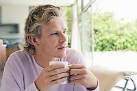 Man Enjoying a Beverage