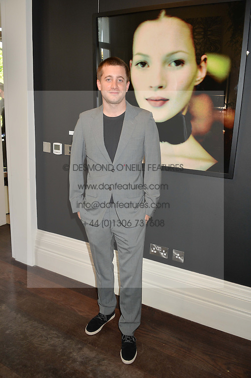 TYRONE WOOD at a private view and launch of the new Heist Gallery at 43 Linden Gardens, London W2 on 12th June 2014.