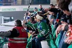 Fan catches the hockey stick during ice-hockey match between HDD Tilia Olimpija and EHC Liwest Black Wings Linz in 37th Round of EBEL league, on Januar 9, 2011 at Hala Tivoli, Ljubljana, Slovenia. (Photo By Matic Klansek Velej / Sportida.com)