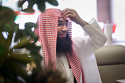 """Fouad Belkacem, a.k.a. Abu Imran, an Islamic extremist who is spearheading the movement """"Sharia4Belgium"""", shares his views during an interview, in Antwerp, Belgium on Tuesday, April 3, 2012. (Photo © Jock Fistick)"""