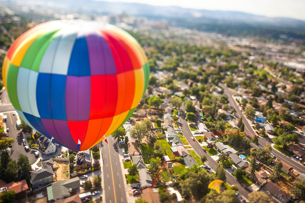 """Balloon Over Reno 2"" - This hot air balloon was photographed over Reno, Nevada during the 2011 Great Reno Balloon Race. The ""toy"" like effect was achieved using a tilt-shift lens."