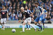 Derby County midfielder Will Hughes (19) and Brighton central midfielder, Dale Stephens (6) during the Sky Bet Championship match between Brighton and Hove Albion and Derby County at the American Express Community Stadium, Brighton and Hove, England on 2 May 2016.