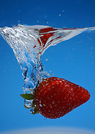 This photo captures a strawberry's plunge.