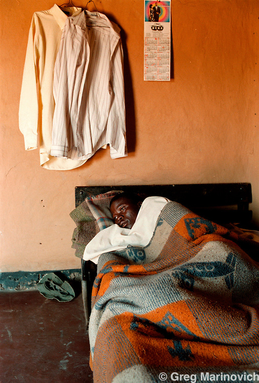 IPMG0101 South Africa, Tugela Ferry 2000: .A young man ill with TB, and has Aids, Msinga, KwaZulu Natal, South Africa, Aug 2000. Southern Africa has the highest per capita Aids sufferers, and KwaZulu Natal is the worst hit province..Photograph by Greg Marinovich