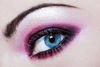 caucasian woman colored eye makeup detail pink eyeshadow