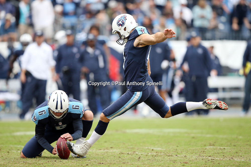 Tennessee Titans punter Brett Kern (6) holds as Tennessee Titans place kicker Ryan Succop (4) kicks a first quarter extra point that gives the Titans a 7-0 lead during the 2015 week 7 regular season NFL football game against the Atlanta Falcons on Sunday, Oct. 25, 2015 in Nashville, Tenn. The Falcons won the game 10-7. (©Paul Anthony Spinelli)