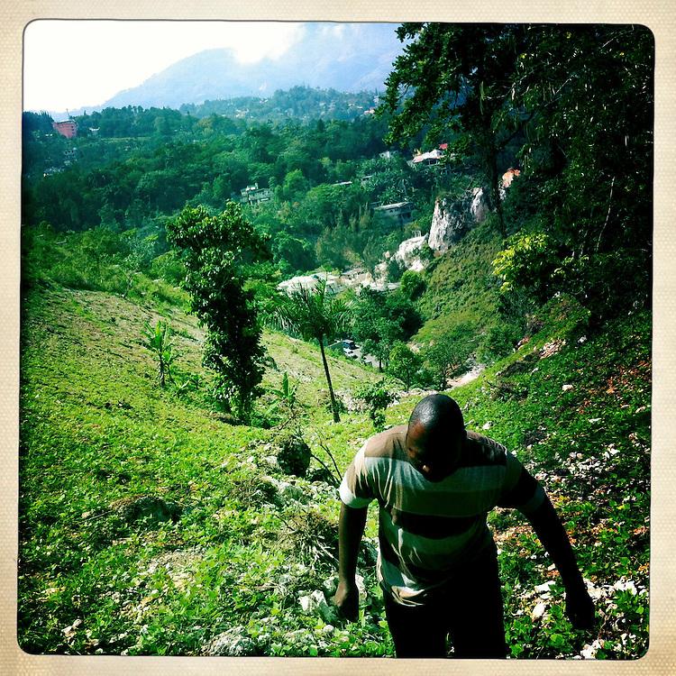 Enok climbs a hill on Tuesday, April 3, 2012 in Laboule, Haiti.