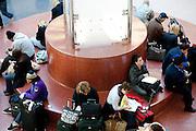 People wait in the lobby in Hartsfield-Jackson Atlanta International Airport in Atlanta, Georgia outside of the screening area January 6, 2009.
